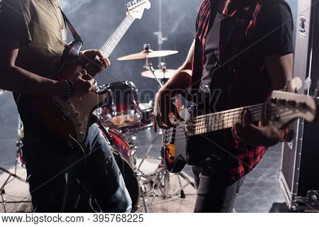Kyiv, Ukraine - August 25, 2020: Cropped View Of Rock Band Musicians With Electric Guitars On Blurre