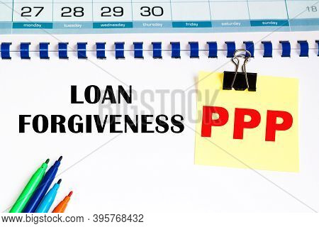 Ppp Loan Forgiveness. Colorful Sticky Note Paper With Pencil And Calendar On White Background, Meeti