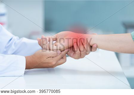 Close Up Doctor Examining Patient With Wrist Bone Problems Painful Wrist Caused By Prolonged Work On