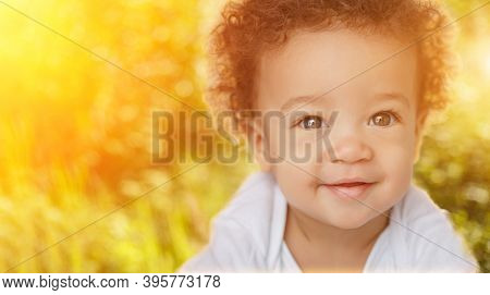 Cute Baby on nature. Happy child in sun backlight. Happy  adorable child, happiness and people age concept. 