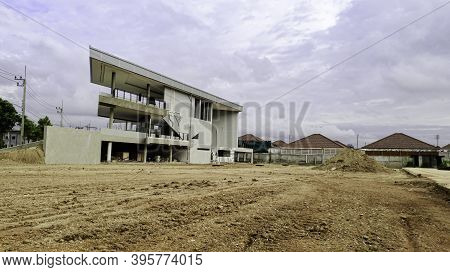 Unfinished Building Of House. Construction Site Of House With Landscape Mountain Background, Backgro