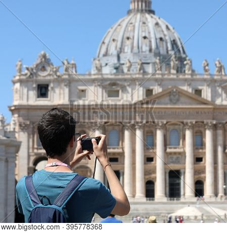 Photographer While Taking A Picture At Square Of Saint Peter With Basilica In The Vatican City In Ce