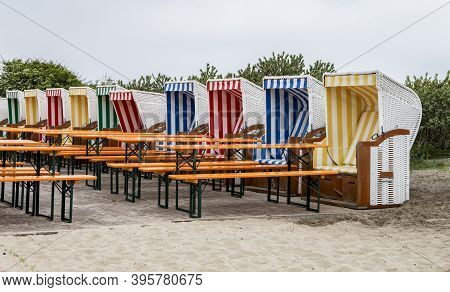 The Photo Shows Several Beach Chairs With Tables And Benches In A Restaurant On Baltrum