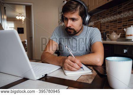 Focused Young Man Wear Headphones Study Online