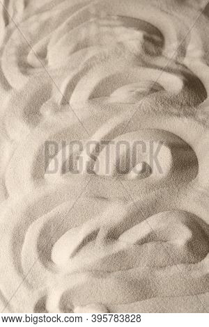 Sand Surface Texture With Smooth Lines And Shadows, For Relaxation And Spiritual Harmony. Garden Of