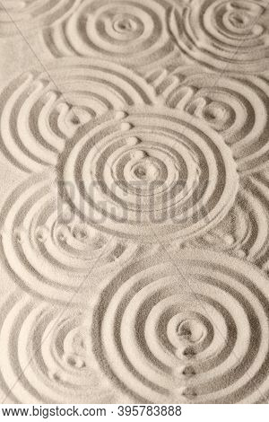 Sand Surface Texture With Circles And Shadows, For Relaxation And Spiritual Harmony. Garden Of Medit