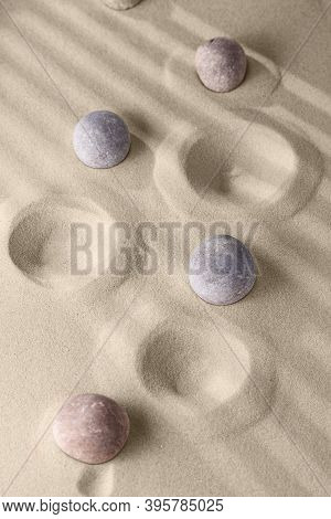 Round Stones On Smooth Sand In The Rock Garden, For Relaxation And Spiritual Harmony. Zen Garden Of