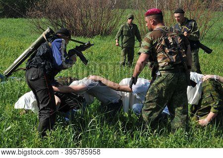 JURGA, SIBERIA, RUSSIA - JUNE 7,2011:Hostages taken prisoner. Courses for war correspondents