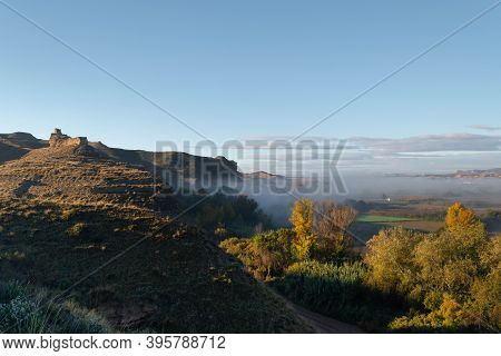 Ruins Of The Arab Castle In Maria De Huerva Near Zaragoza Early In The Morning With Mist In The Vall