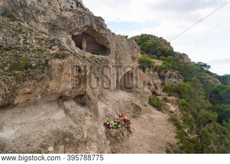 Small Sanctuary With Offerings To The Virgen Del Pilar In The Middle Of The Nature On The Ascent To