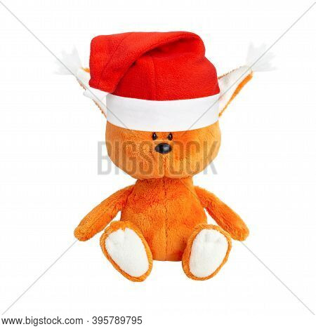 Cute Plush Orange Squirrel In A Red Santa Hat Isolated On White Background. Christmas Or New Year Pl