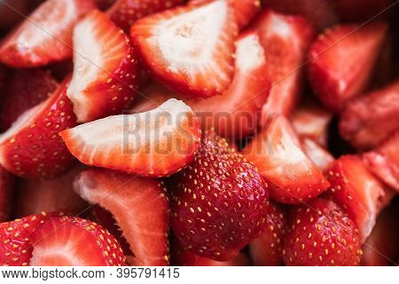 Background Texture Of Sliced Strawberries Red Fresh.