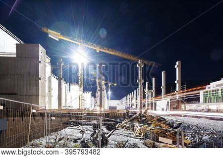 Floodlit Tower Crane On Building Construction Site At Night