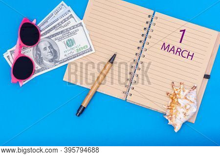 March 1. 1st Day Of March. Travel Plan Flat Design With Notepad Written Date, Pen, Glasses, Money Do