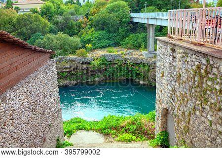 Neretva Riverside And Bridge In Mostar From Bosnia And Herzegovina