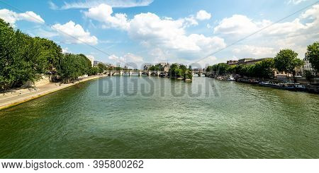 White Clouds Over World Famous Seine River In Paris, France