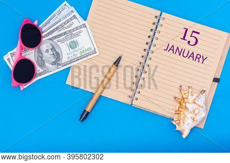 January 15. 15th Day Of January. Travel Plan Flat Design With Notepad Written Date, Pen, Glasses, Mo