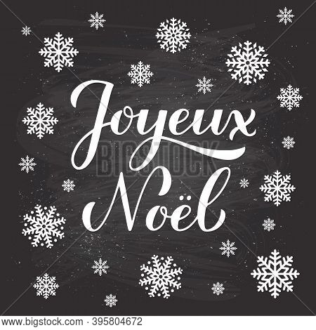 Joyeux Noel Calligraphy Hand Lettering On Chalkboard Background With Snowflakes. Merry Christmas Typ