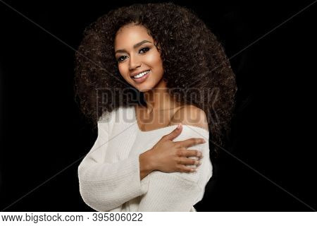 Beauty black skin woman African Ethnic female face. Young african american model with long afro hair. Lux model on black.