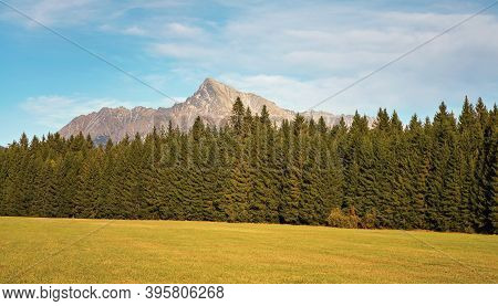 Mount Krivan Peak Slovak Symbol Wide Panorama With Autumn Meadow In Foreground, Typical Autumnal Sce