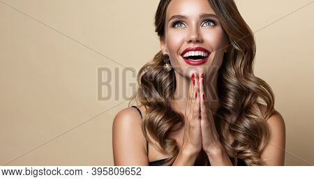 Young , Toothy Smiling Woman Is Looking Up Above With Expression Full Of Joy And Pleasure.curly Hair