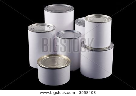 White Tin Cans On Black Background