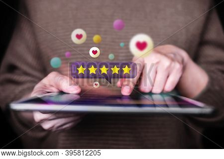 Customer Experiences Concept. Closeup Of  Woman Using Digital Tablet To Giving Feedback Via The Inte