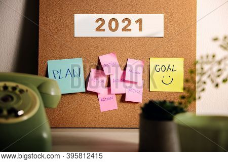 Goal, Plan, Challenge And Strategy For 2021 Year Concept. Sticky Note On Cork Board On Working Desk.