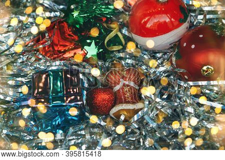 Festive Tinsel, Balls And Baubles Abstract Christmas Background.