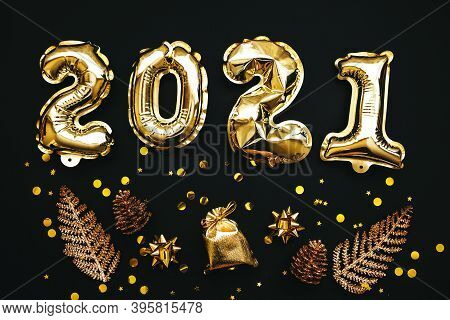 Gold Numbers 2021 And Next To Them Holiday Items On A Black Or Dark Background. Christmas Or New Yea