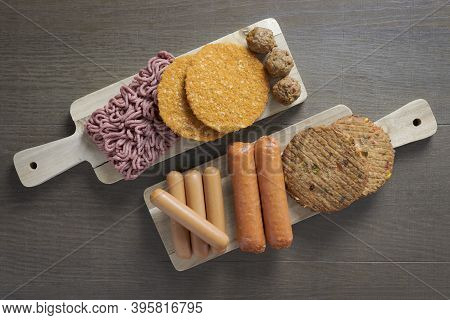 Flat Lay Of Plant Based Vegetarian Meat Products For A Plant Based Diet On A Wooden Table, , Veggie