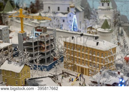 Miniature Construction Of A High-rise Building With A Tower Crane.