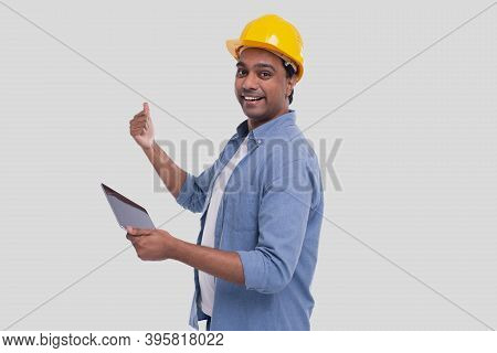 Construction Worker Holding Tablet In Hands Showing Back. Man Using Tablet. Architect Holding Tablet