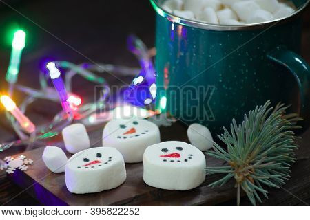 Christmas Mug With Hot Drink And Marshmallows And Tree Spruce Branches With Beautiful Garlands. Figu
