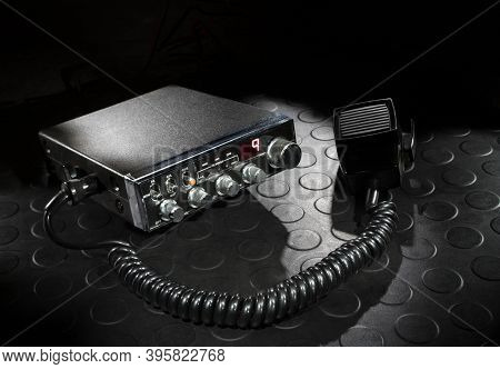 Two Way Radio On The Emergency Channel With A Dark Background On A Rubber Mat