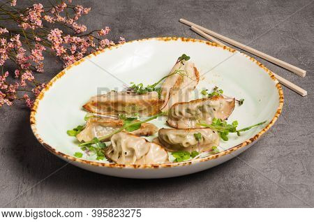 Gyoza Fried With Pork Ginger Sesame Oil And Soy Sauce