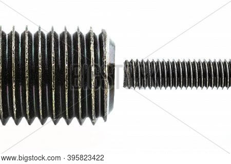 A Background Made From A Macro Shot Of A Grease Coated Black Screw Thread, Isolated On A White Backg