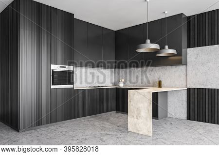 Dark Wooden Kitchen In Apartment, Side View, Black Kitchen Set And Pendant Lamps Over A Table, Grey