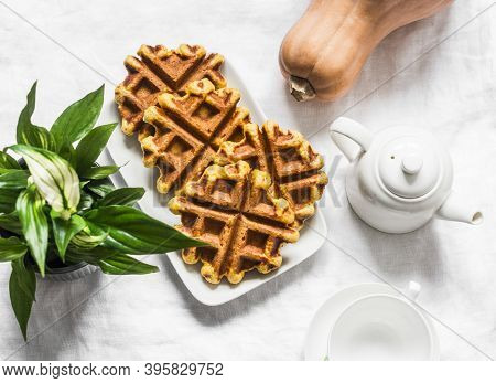 Pumpkin Oatmeal Wholemeal Waffle On A Light Background, Top View. Delicious Breakfast, Snack