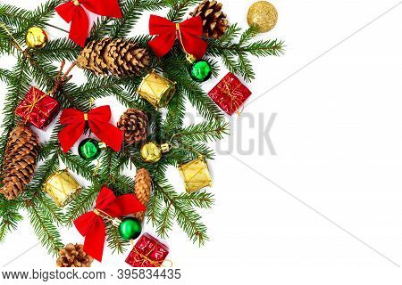 New Year And Christmas Background On A White Background With Fir Branches, Cones And Christmas Parap