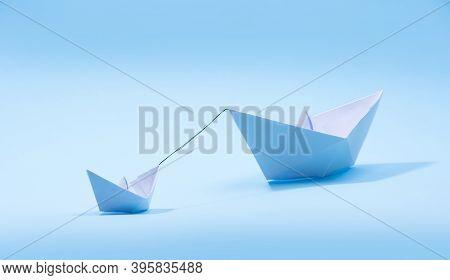 Paper Boats - Tugboat Or Remorker Pulling A Big Boat On Blue Background. Little Helper Concept, Tugb