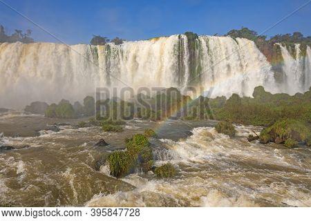 Raging Waters And Verdant Growth Below The Falls At Iguazu Falls In Brazil