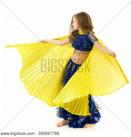 Beautiful Blonde Long Haired Girl Dancing Belly Dance With Wings, Lovely Child In Traditional Blue D