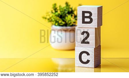 B2c - Acronym From Wooden Blocks With Letters, Business-to-consumer. Yellow Background.