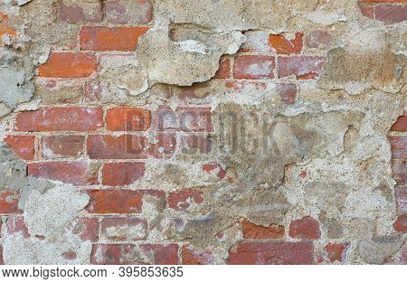 Old Brick Wall Texture. The Wall, Made Of Old Red Bricks, Darkened By Old Age. Ancient Vintage Brick