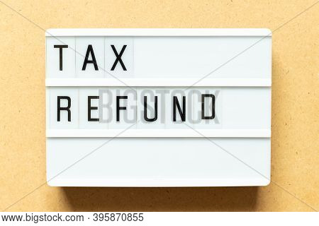 Lightbox With Word Tax Refund On Wood Background
