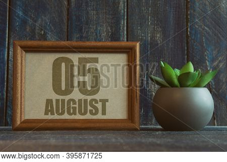 August 5th. Day 5 Of Month, Date In Frame Next To Succulent On Wooden Background Summer Month, Day O