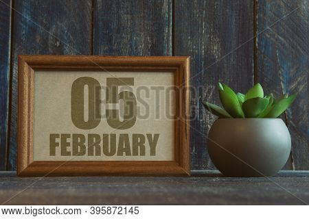 February 5th. Day 5 Of Month, Date In Frame Next To Succulent On Wooden Background Winter Month, Day