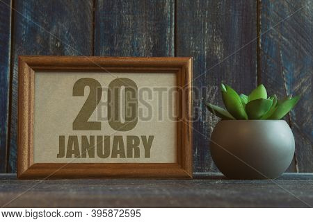 January 20th. Day 20 Of Month, Date In Frame Next To Succulent On Wooden Background Winter Month, Da