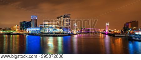 Salford Quays business district at night in in Manchester, England, United Kingdom